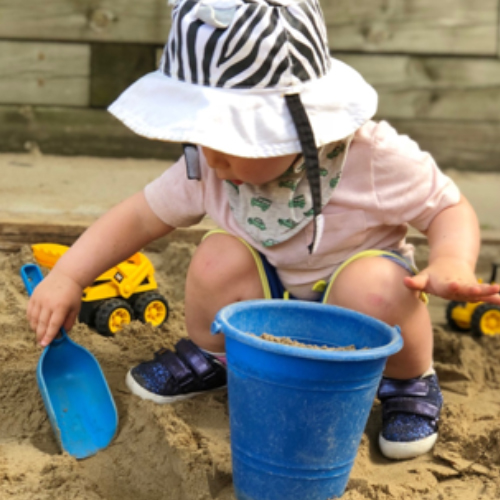 Infant playing in the sand